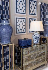 The Georgia porcelain lamp and Window Blue Panel are an example of modern blue and white. Accented with our blue malachite box.