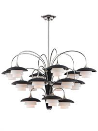 In the first half of the 20th century, Danish architecture attempted to address the issue of harsh glare sometimes inherent in electric light. The Barron collection by Hudson Valley Lighting applies this solution of layered, curved shades to light fixtures with a floral bent. Finely textured and painted black on the outside, with a metal finish on the inside, Barron's shades are a visual delight in person. Opal-etched diffusers nested in pairs within each shade further soften and diffuse the light. Barron