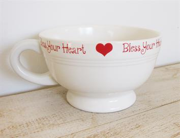 Bless Your Heart is one of many whimsical designs we offer in our 24 oz SOUPer sized footed mugs.