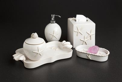 Our handmade ceramic stoneware bath and vanity accessories are embellished with a raised life-like ceramic starfish and shell-like handles. Choose from 3 marine inspired colors, Ocean, Cloud and Sand.