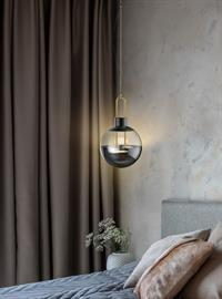 Interesting LED family with pendant showing a cross of contemporary and transitional with brass trim, light up and down. Comes in pendants, flush mounts, wall sconces and portables.