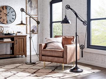 Garrett and Garrad floor lamps from Lite Source features pulley and wheels with detailed designs and precise alignment. An Edison bulb adds to the antique style, which stands as a collectable piece of art in the house.