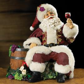 "Grab a glass of wine and join this 9"" Kurt Adler Fabriché Santa with smiles and cheers.  This piece features Santa sitting down in a burgundy suit next to a barrel with grapes hanging off the barrel and around it."