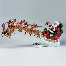 "Part of Kurt Adler's Fabriche collection, this 24"" Santa Claus and reindeer set of 2 is a fun and perfectly festive addition to any holiday décor! Plays ""Santa Claus is Coming to Town."""