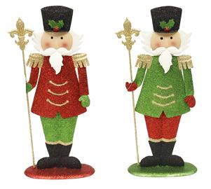 "These charming 14"" glitter tin Nutcrackers are a wonderful classic holiday decoration. The details of the green holly and red berry on its black glitter hat, to the staff it holds, he is sure to be a great addition to your holiday décor!"
