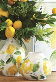 A fresh squeezed approach to a classic style combining sunflowers with lemons and accents of ferns.