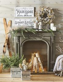 Traditional lodge motifs are updated with chic and shimmering shades of gold to create an elegant lodge environment.