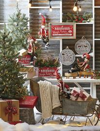 - A natural woodland theme featuring Santa's trusty reindeer. Mixed metals and natural wood tones are accented with pops of red.