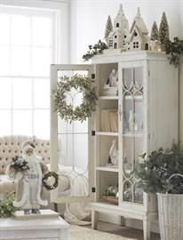 This casual farmhouse Christmas brings the outdoors in with natural greenery, botanicals and distressed finishes