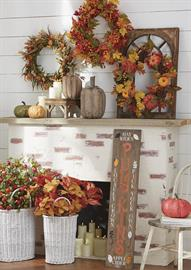 A collection of all things fall. Pumpkins, berries and mums adorn stems, wreaths and other home décor.