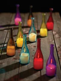 "New, versatile glass bottles incorporate flameless LED candle. Available in 5 fun colors fitting for any setting. Measures: 10"" H."
