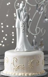 "This beautifully made wedding cake topper stands at 8""H."