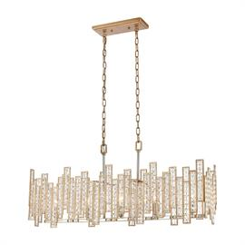 12136/5 – Metal strips of varying heights return to a harmonious balance in the Equilibrium collection 5 light linear chandelier. Geometric shapes are joined together at varying heights for intended design driven asymmetry. Each strip is laced with glass beads and clear crystals adding additional texture. The Matte Gold finish has Polished Chrome accents which gives the design extra sparkle.