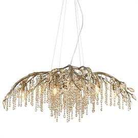 Like dewdrops under a forest canopy, Our Autumn Twilight collection features glistening crystals that cascade from organic leaves and branches. This nod to nature gets a modern twist with a Mystic Gold finish, making it a natural in contemporary settings. G4 halogen bulbs provide an inner source of illumination allowing light to sparkle and reflect playfully off the countless gleaming surfaces, sparking both curiosity and conversation.