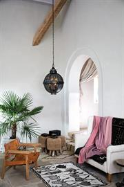 All roads lead to Miramar, where an exotic blend of Moroccan and vintage elements meld past and present. An open chimney with a decorative loop and cast knobs adds character while metal cut outs in a Black finish and brass accents enrich this pendant collection's texture and depth.
