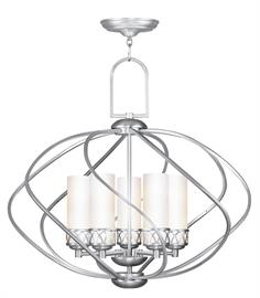 The transitional Westfield collection has a sophisticated style combining intensely divergent design elements. The rustic wrought iron has been hand-crafted into soft, flowing curves, and the cylindrical hand blown satin opal white glass create a striking contrast to the brushed nickel finish.