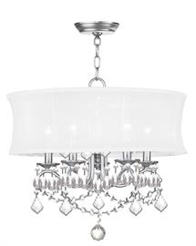 Add glamour to your home with this enchanting shaded chandelier. Scrolling arms adorned in a brushed nickel finish are paired with glittering crystal drops that reflect light when illuminated. A white handmade silk shimmer shade completes this chic design.