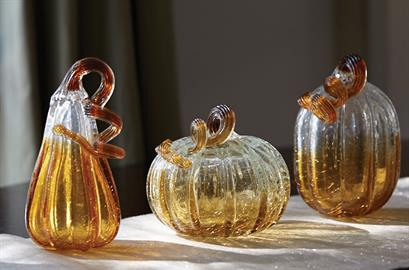 Autumn colors shine with this decorative trio of pumpkins for seasonal accents.