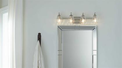 The Anjoux Collection is distinctive with casual crystal details. The four-light bath and vanity fixture features clear water glass shades and an Antique Bronze finish with champagne bronze accents. Anjoux is a truly versatile lighting collection that can complement a wide range of design spaces.