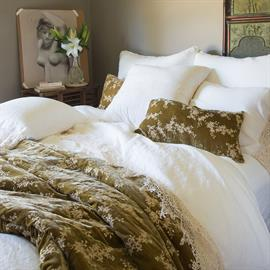 Two-tone embroidery on silk velvet, Lynette's personal comforter is an elegant statement piece. Perfect for your reading chair or the foot of your bed.