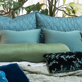 Cenote (Luna Shams and Madera Luxe Pillowcases) and Eucalyptus (Luna Coverlet) are joined by Jade, our greenest of greens — shown here in a Paloma Bolster and Lynette Accent Pillow.