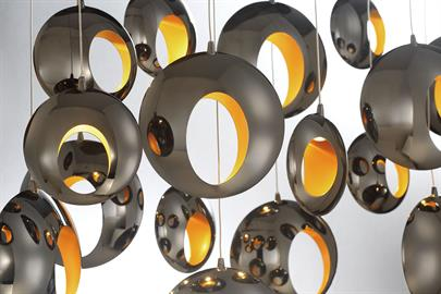 Hollowed orbs of blackened chrome LED are reminiscent of molten lava. Each hollowed orb is highlighted with a golden interior. A weightless design, buoyantly floating add an effervescent character to your décor.