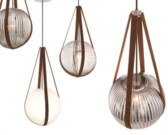 Pendulous glass orb supported by real leather straps offers the illusion of an effortless balancing act. Whether in clear ribbed glass, smoke colored ribbed glass, or opal smooth glass, this remarkable spherical pendant is sure to make an impression.