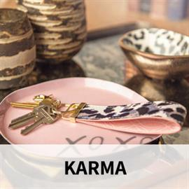 Karma... Spirited, Stylish, Smart. Eclectic prints with distinctive global flair and boho attitude. Fashionable apparel, practical fashion accessories, playful lifestyle products. Captivating mixed fabrics, compelling appliqued embroidery and inspired hidden messages.