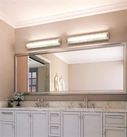 The Stowe collection of high quality LED vanities is blended with unique materials. It has a opal white cylinder glass, organic shell backing and a chrome plated bracket. This LED model is dimmable.