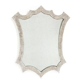 Designed with hints of natural wood, grays and blues, this mirror adds a little rustic found pop to any room.