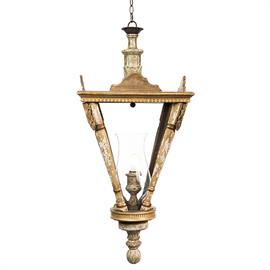 Quintessentially French, this dramatic lantern developed from architectural fragments is the perfect way to add a sophisticated look to any room.  Available in two sizes.