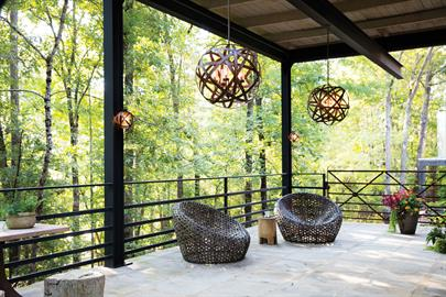 Carson features bold overlapping metal ribbons of Iron Rust or Weathered Zinc, enhancing an outdoor living area with style and substance. The hand-crafted pendants combine a hint of industrial sophistication with the allure of artisan craftsmanship.