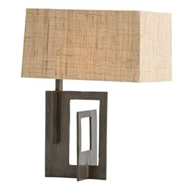 "The Otis Lamp is geometric, unconventional and purposely off-center. Open detail panels intersect to create the natural iron base. The off-center textured fiber shade conceals a horizontal socket and is lined in matching cotton. A sculpture any art lover would appreciate. H: 17.5"" W: 13"" D: 9.5"" #42010-104"