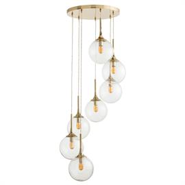 "Seven seeded clear glass spheres spiral downward from the large round polished brass canopy, seemingly to float through the air. Perfect for any vertical space that needs drama and sparkle. Shown with radio bulbs. H: 67"" Dia: 24"" #89964"