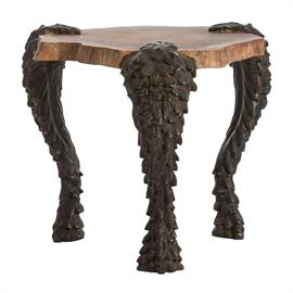 "The Grotto table combines historical motifs with a modern silhouette. A trio of serpentine cast aluminum legs are finished in natural black and gracefully curve to support the solid wood top. The waxed finish on the Sheesham wood highlights the exposed ring detail and provides an interesting contrast to the serpent legs. This piece is guaranteed to get a conversation started. H: 21"" W: 24"" D: 24"" #DD2057"